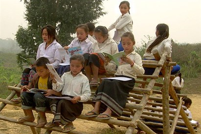 Lao _students _reading _their _first _books